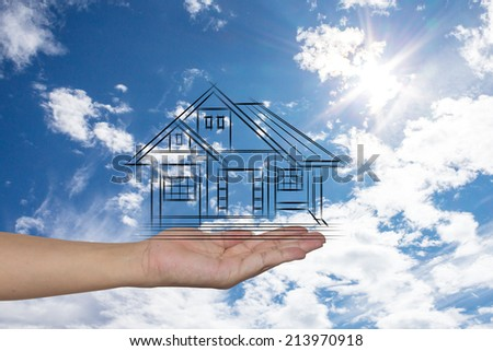 real estate, technology and accommodation concept - picture of house on virtual screen in man hand - stock photo