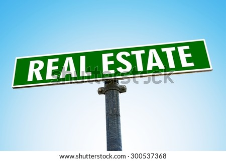 REAL ESTATE word on green road sign - stock photo