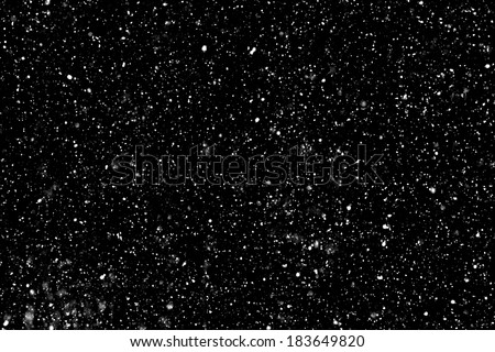 "Real falling snow on a black background for use as a texture layer in your project.  Add as ""Lighten"" Layer in Photoshop to add falling snow to any image.  Adjust opacity to taste.    - stock photo"