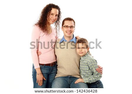 real family of three smiling