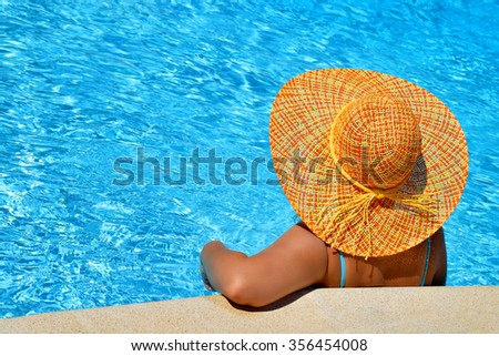 Real female beauty enjoying her summer vacation at swimming pool