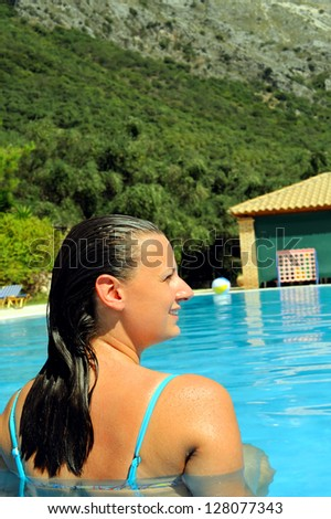 Real female beauty relaxing in swimming pool