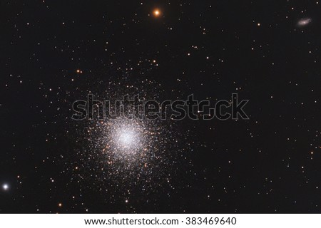 Real globular cluster Messier13 in Hercules taken with CCD and telescope - stock photo