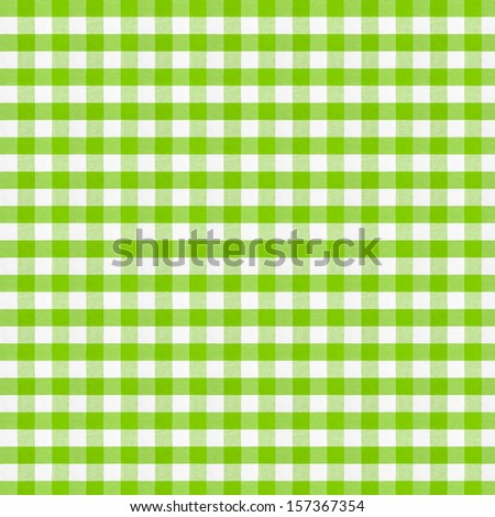 Real green checkered fabric tablecloth.  - stock photo