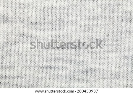 Real grey knitted fabric made of heathered yarn textured background