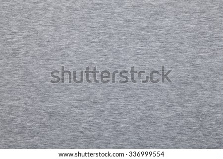 Real heather grey knitted fabric made of synthetic fibres textured background - stock photo