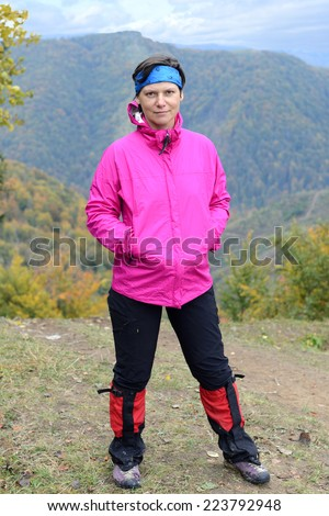 Real hiker in autumn day - stock photo