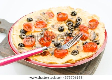 Real homemade tortilla with mushrooms tomatoes and olives