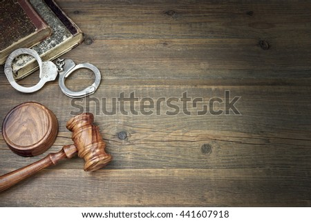 Real Judges Hammer, Handcuffs And Old Law Book On The Grunge Wood Table In Courtroom, Top View, Copy Space, Justice Concept - stock photo