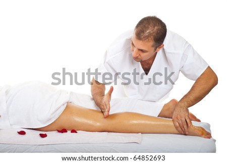 Real masseur give friction massage type to woman's leg - stock photo