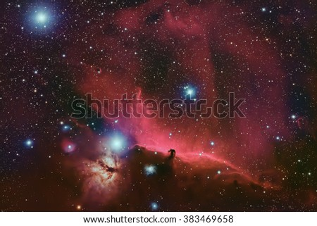 Real Nebula called Orion Molecular Cloud Complex Wide Field aimed at the belt of the constellation Orion taken by large CCD Camera on a 530mm focal length telescope - stock photo