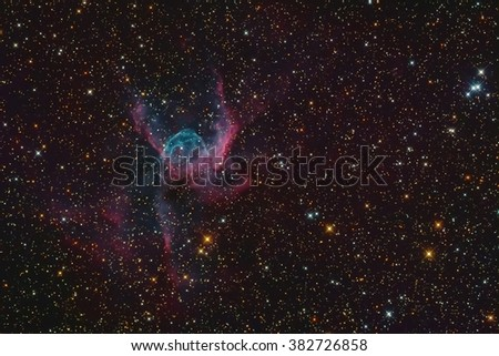 Real Nebula called Thorâ??s Helmet or NGC 2359 is an emission nebula located in the southern constellation Canis Major. Taken through telescope and CCD camera. - stock photo