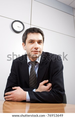Real office worker posing for camera in board room