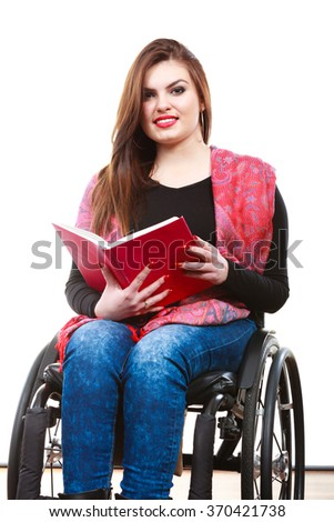 Real people, disability and handicap concept. Teen girl unrecognizable person sitting on wheelchair reading book studio shot on white - stock photo