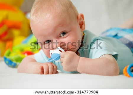 Real People: Headshot Smiling Caucasian Baby Boy  - stock photo
