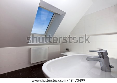 Real photo of a modern bath room of a city-flat with skylight window. ( no digital manipulation ) - stock photo