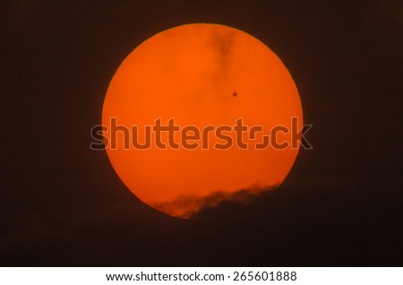 Real picture of the sun with a big sunspot group over the dark cloud by telescope focal length 600mm, 2x teleconverter - stock photo