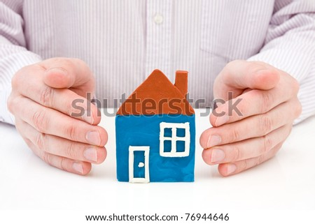 Real property or insurance concept. hands with plasticine house. - stock photo