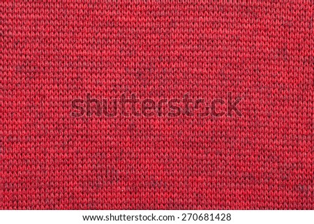 Real red knitted fabric made of heathered yarn textured background - stock photo