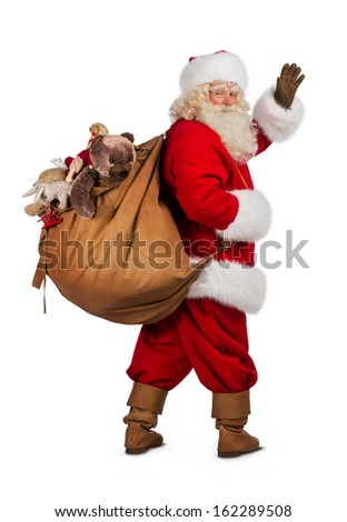 Real Santa Claus carrying big bag full of gifts, isolated on white background - stock photo