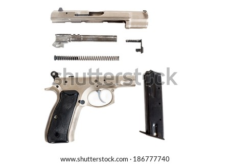 real Semi automatic gun disassembled on white background - stock photo