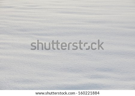 Real snow surface cover for background texture usage - stock photo