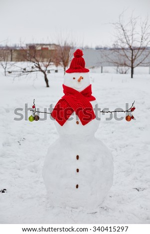 Real snowman outdoors in winter white scenery.