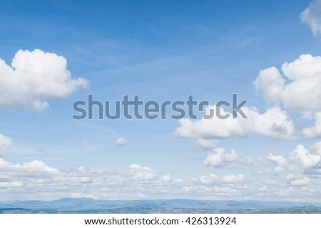 Real soft white clouds against blue sky with copy space for background design - stock photo