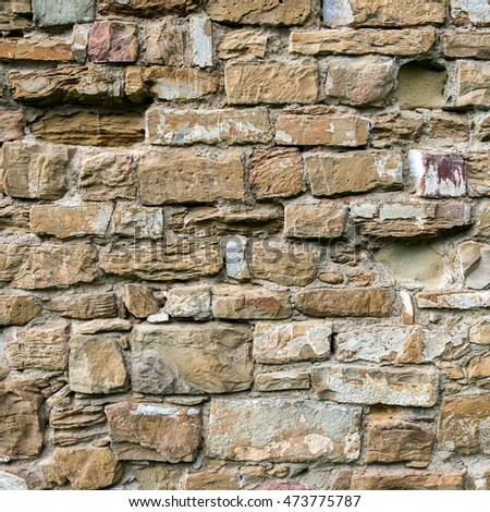 Real texture of old yellow-brown stone brickwork. Bricks quality photo background. Good for 3D works or wallpaper, backdrop