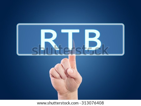 Real Time Bidding - hand pressing button on interface with blue background. - stock photo