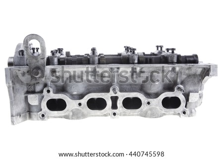 real used car motor head engine four cylinder isolated over white background - stock photo