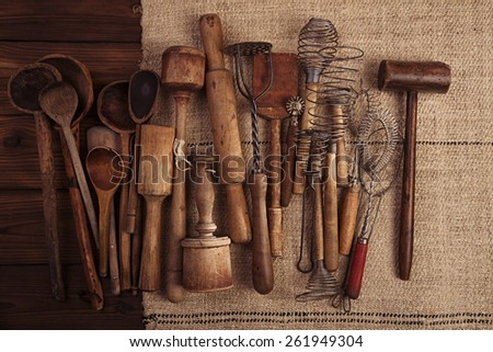 real vintage kitchen utensils on old grain sacking linen Completely hand made  handwoven and homespun - stock photo