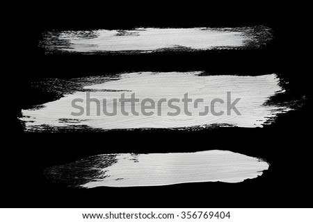 real white brush strokes with detailed texture on black - stock photo