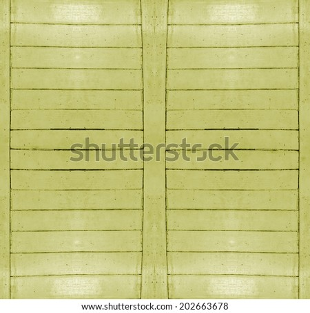 Real wood wall background with horizontal lines molders with borders in yellow tones. - stock photo
