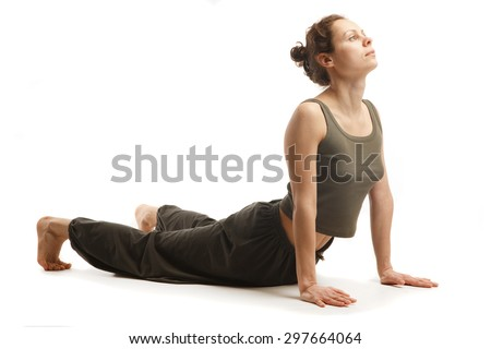 Real yoga instructor is doing complicated yoga pose