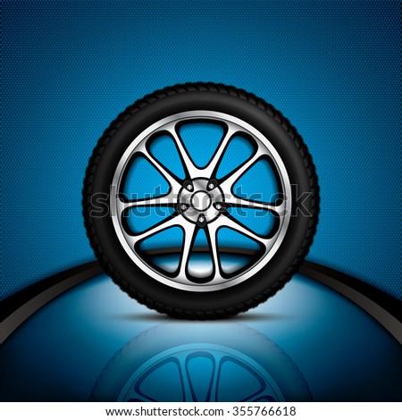 Realistic car wheel with shining rim - stock photo
