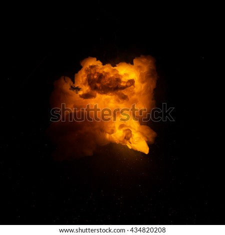 Realistic fiery explosion over a black background - stock photo