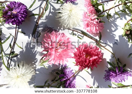 Realistic floral pattern on a white background. Violet flowers, pink flowers, white flowers abstract pattern seamless. Random flowers repeating on a white. Artistic Photo collage for floral design. - stock photo