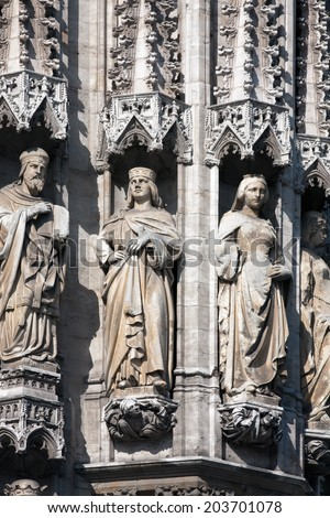 Realistic gothic statues decorating medieval facade of Grand Place in Brussels, Belgium - stock photo