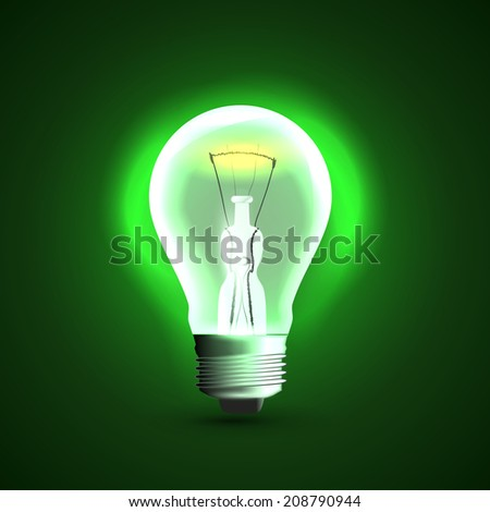 Realistic light bulb. On green background - stock photo