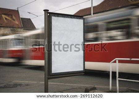 Realistic photo blank billboard with the texture of the poster and highlights. Tram on the background with the effect of Motion blur. For your advertisement or graphic design - stock photo