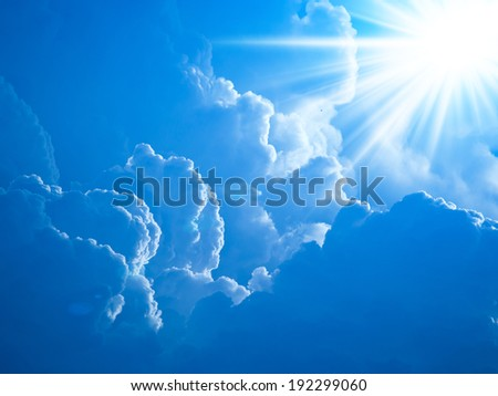 Realistic shining sun with lens flare. Blue sky with clouds back - stock photo