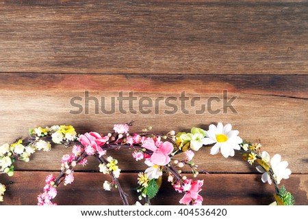 realistic spring flower wreath on old wood background