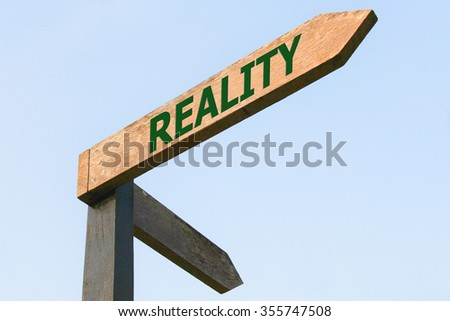 REALITY word on wood roadsign - stock photo