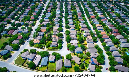 Really high up Aerial Drone View Above Austin Texas Suburb Summer Homes For Sale as Real Estate Ramps up in the Round Rock suburb
