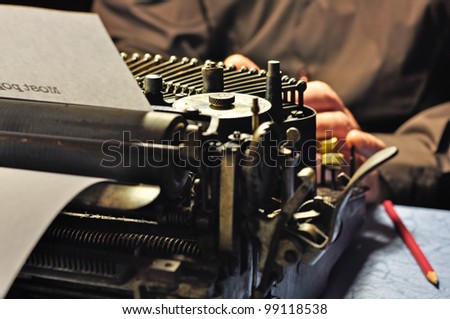 Really old typewriter. Writer in action.