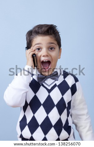 Really young businessman is shocked over the phone. - stock photo