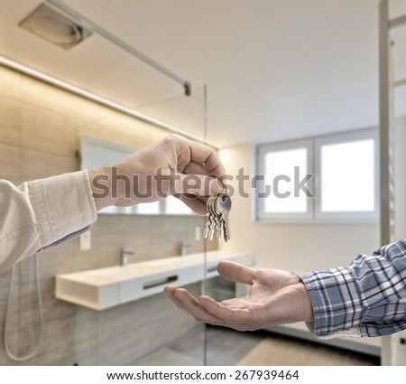 Realtor giving house key to buyer in Luxury Bathroom Estate Home