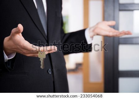 Realtor's hand holding keys to new home