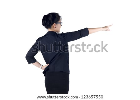 Rear / Back view of business woman standing and pointing. Isolated white background. Model is Asian woman. - stock photo